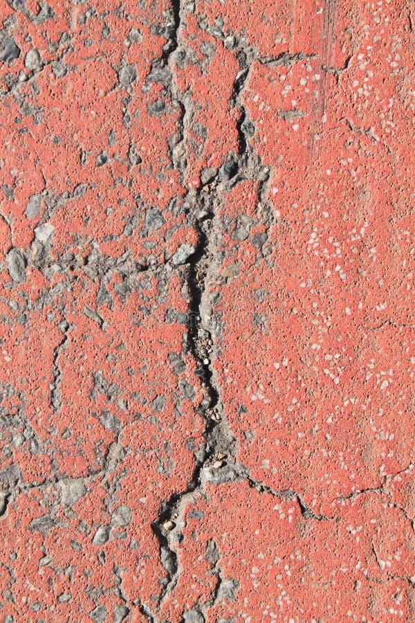 Textura envelhecida da parede do cimento, fundo rachado da rocha, superfície áspera imagens de stock