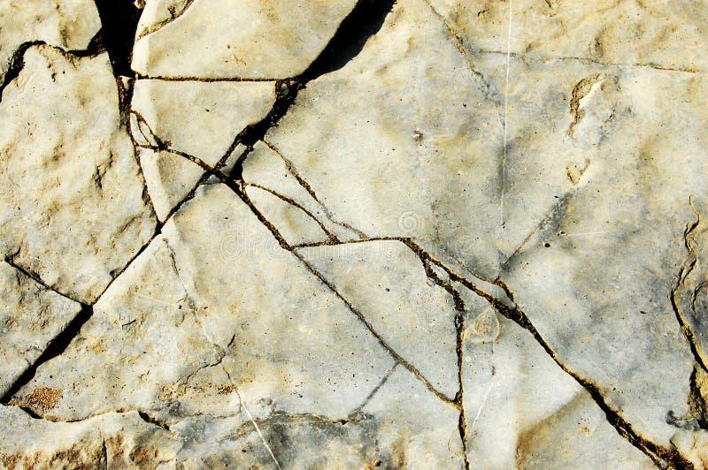 Textura erosionada agua de la roca de fondo del río imagen de archivo libre de regalías