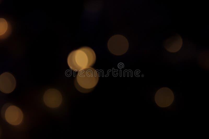 Textura escura de brilho do fundo do bokeh fotografia de stock royalty free