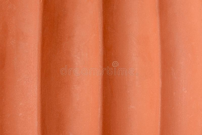 Textura excelente de una forma cilíndrica hecha de marrón plástico imagen de archivo libre de regalías