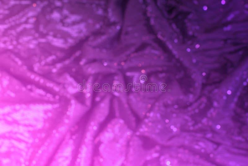 Textura festiva del fondo que riela del defocus de neón rosado brillante imagenes de archivo