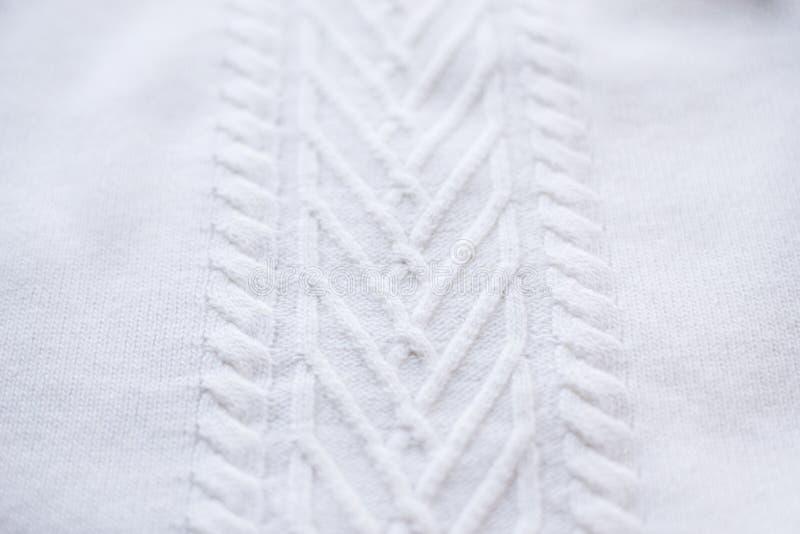 A textura fez malha a camiseta, raios de tiragem da trança, imagem de stock