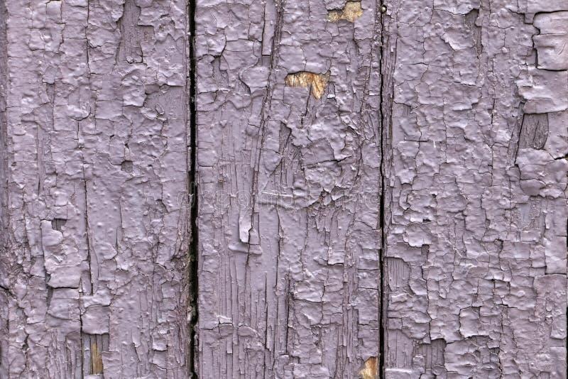 Textura, fondo de una cerca vieja, de madera con la peladura de la pintura foto de archivo libre de regalías