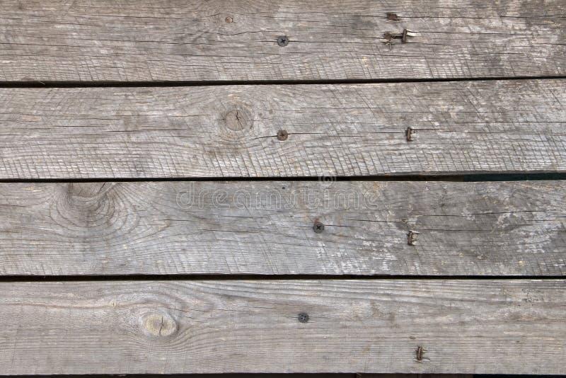 Textura, fondo de una cerca vieja, de madera con la peladura de la pintura imagenes de archivo