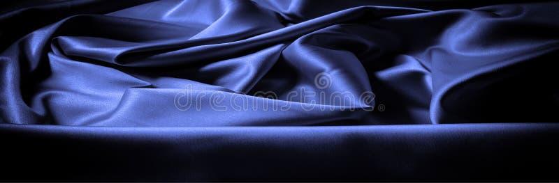 Textura, fondo, modelo Lila azul marino de la tela de seda esto fotografía de archivo libre de regalías