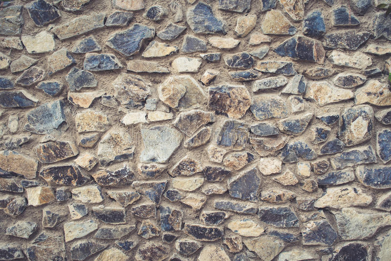 Textura grande de la pared de piedra en colores calientes fotos de archivo libres de regalías