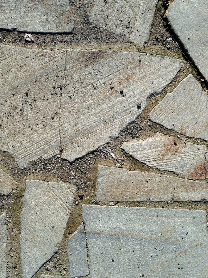 Textura - grandes pedras no concreto fotos de stock
