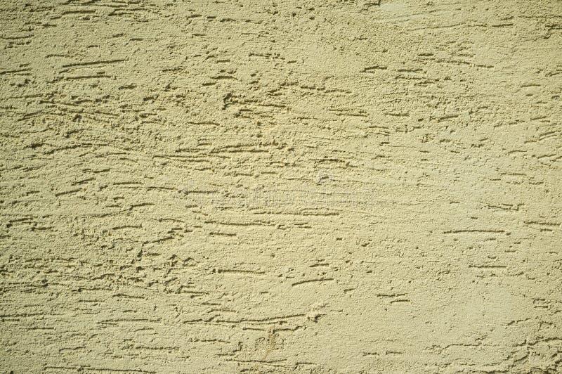 Textura granosa amarilla del extracto de la pared imagenes de archivo