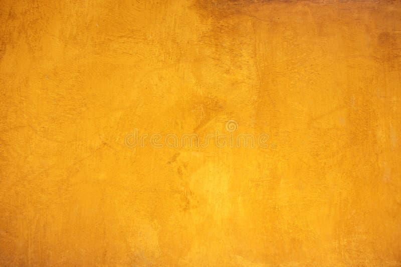 Textura granulado amarela da superfície da parede para o fundo fotos de stock