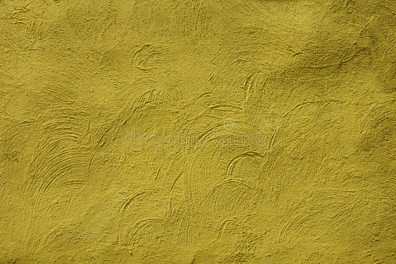 Textura granulado amarela da superfície da parede para o fundo fotografia de stock