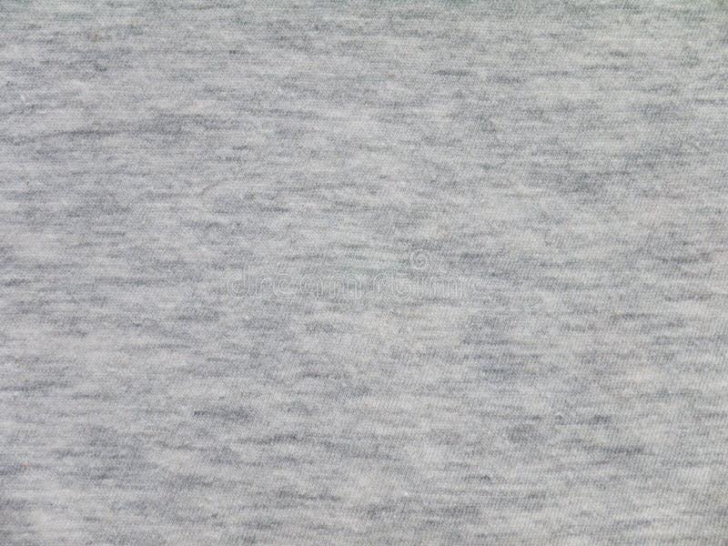 Textura gris de la tela de los géneros de punto fotografía de archivo libre de regalías