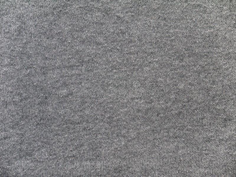 Textura gris de la tela de los géneros de punto del brezo fotografía de archivo libre de regalías