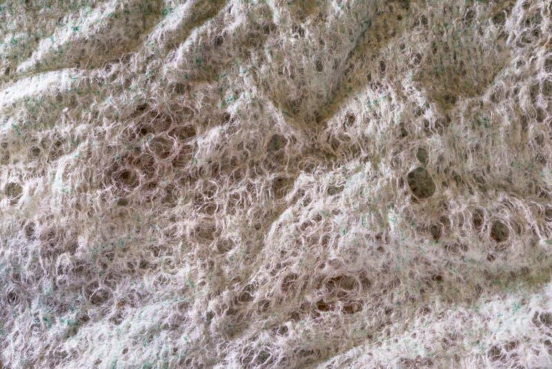 Textura gris de viejo limpiado a los agujeros la tela de las fibras artificiales y naturales, fondo abstracto fotografía de archivo libre de regalías