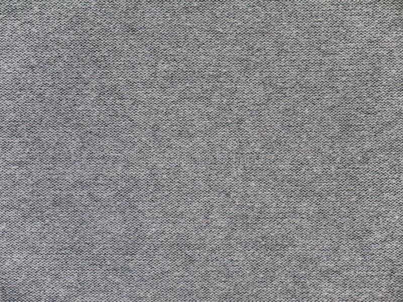 Textura gris del superficie inferior de la tela de los géneros de punto del brezo imagenes de archivo