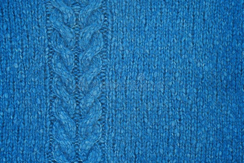 Textura hecha punto azul con un modelo de alivio Géneros de punto hechos a mano foto de archivo libre de regalías