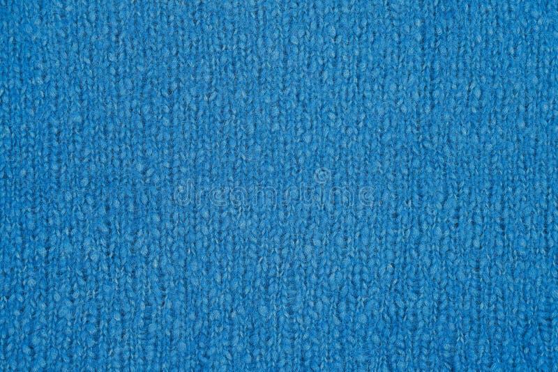 Textura hecha punto azul Géneros de punto hechos a mano Fondo imagenes de archivo
