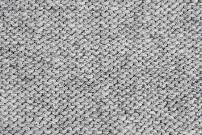 Textura hecha punto gris Géneros de punto hechos a mano Fondo fotografía de archivo