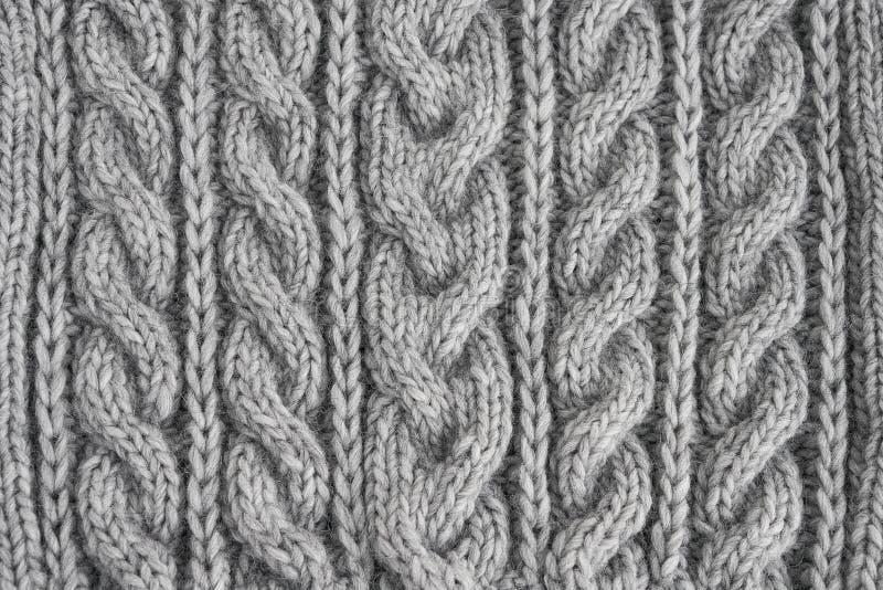 Textura hecha punto gris Géneros de punto hechos a mano Fondo foto de archivo libre de regalías