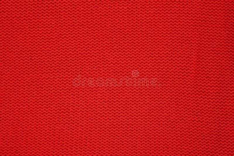 Textura hecha punto rojo Géneros de punto hechos a mano Fondo imagenes de archivo