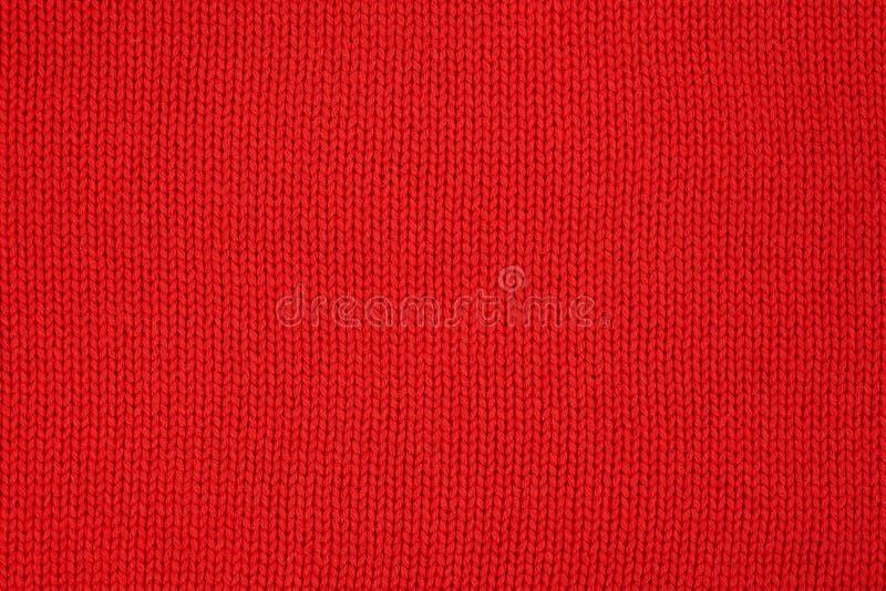 Textura hecha punto rojo Géneros de punto hechos a mano Fondo foto de archivo