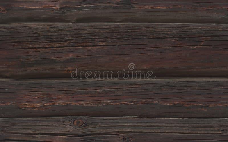 Textura inconsútil de registros de madera fuliginosos oscuros foto de archivo