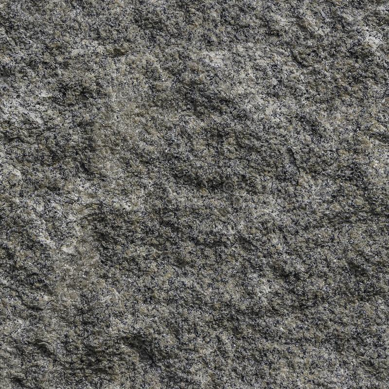 Textura inconsútil del modelo de la superficie de piedra natural del granito gris y amarillo que vemos en la foto foto de archivo libre de regalías