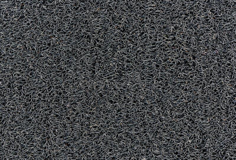 Textura industrial de la estera del piso del coche del modelo de la bobina de la alfombra del negro vinilo fotografía de archivo