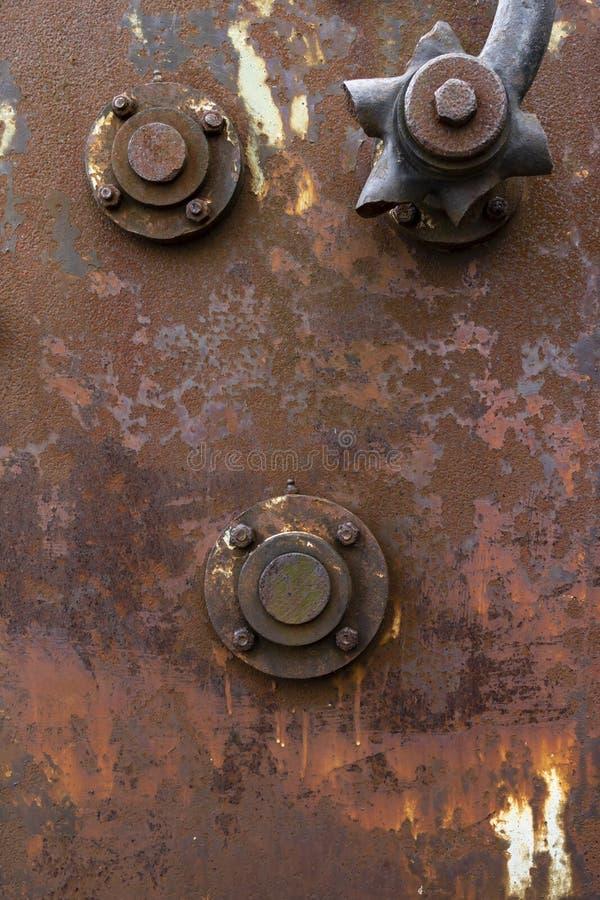 Textura industrial oxidada del panel con empernado en los accesorios imagen de archivo libre de regalías