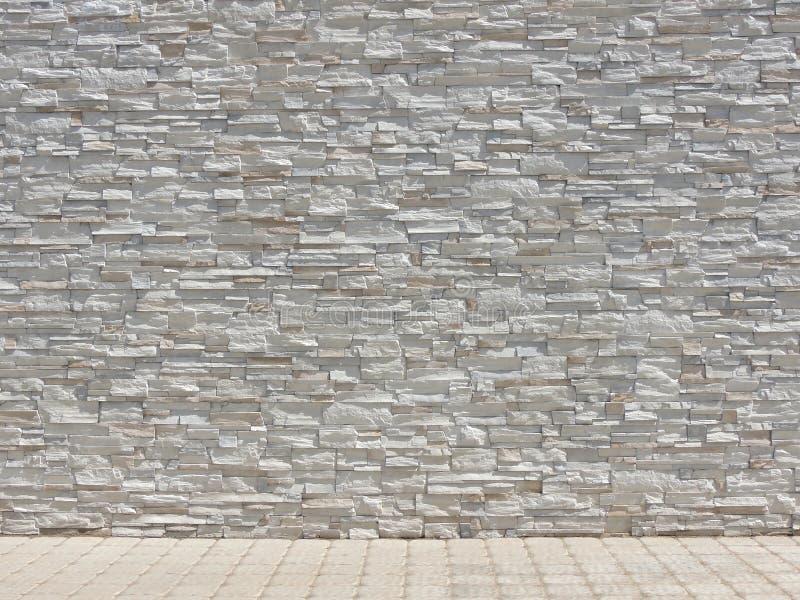 Textura interior de la pared de piedra decorativa y del piso tejado fotografía de archivo