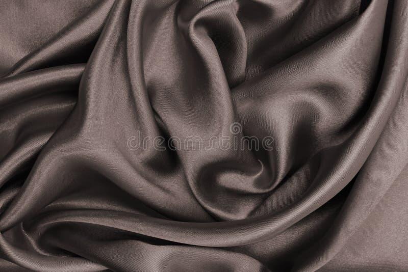 Textura luxuosa azul elegante lisa de pano da seda ou do cetim como o abstra foto de stock