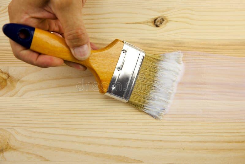 Textura, mão e pincel de madeira imagem de stock