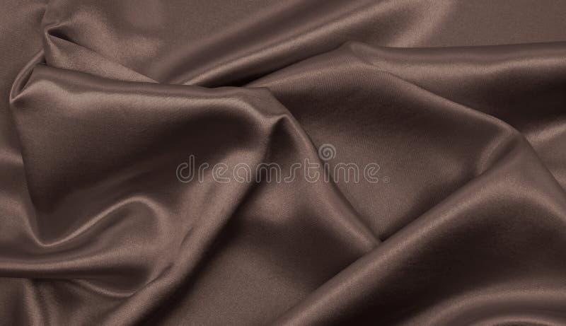Textura marrón elegante lisa de la seda o del satén como backgroun abstracto fotografía de archivo libre de regalías