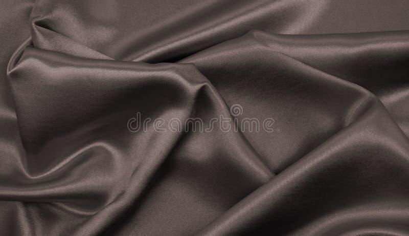 Textura marrón elegante lisa de la seda o del satén como backgroun abstracto fotos de archivo libres de regalías