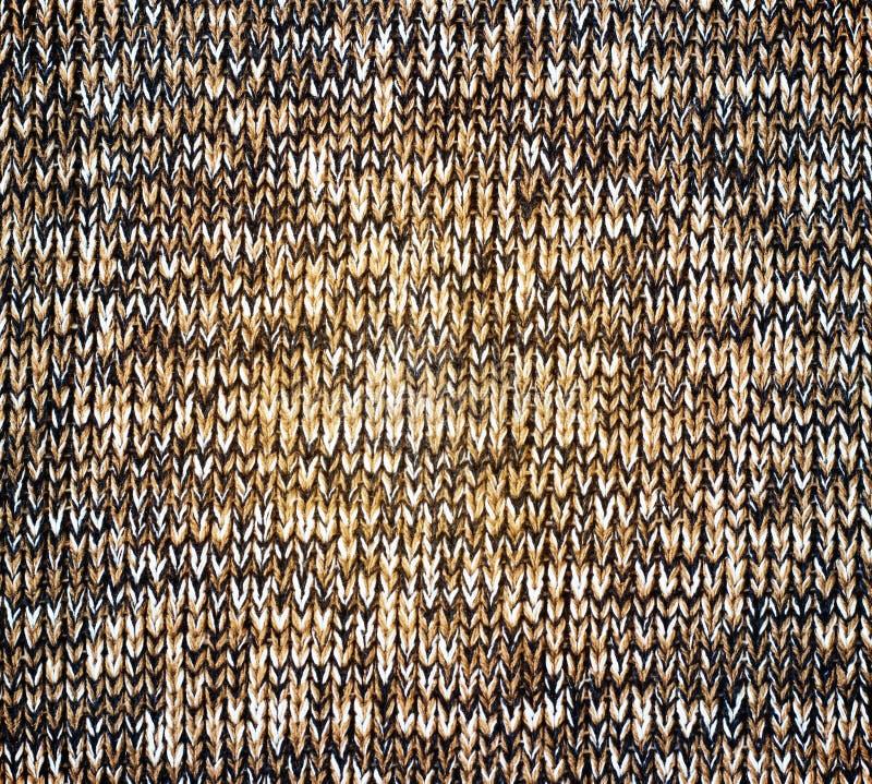 Textura marrón hecha punto del grunge de la lona como fondo foto de archivo
