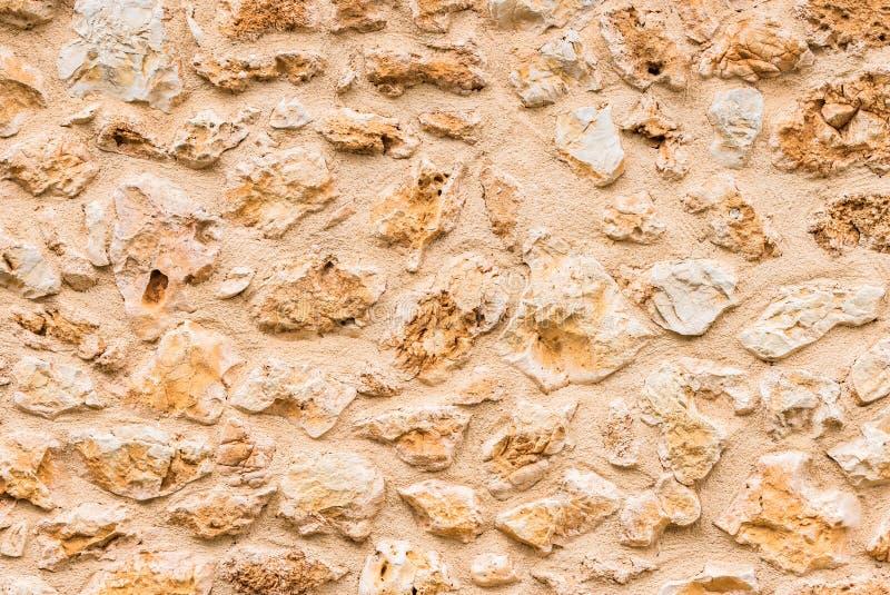 Textura marrom natural do fundo da parede de pedra imagem de stock