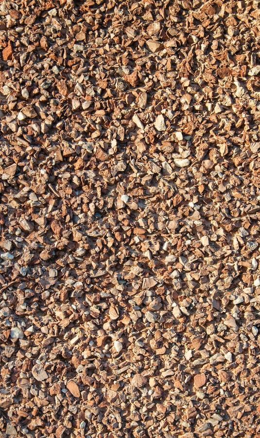 Textura marrom oxidada da parede de pedras Tiro macro fotos de stock royalty free
