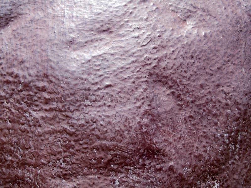 A textura modelada do concreto carmesim vermelho da parede, imagens de fundo imagem de stock royalty free