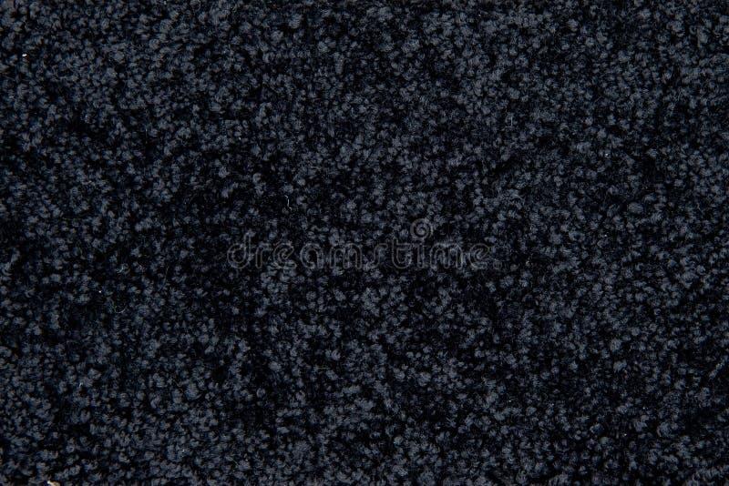 Textura negra de la alfombra fotografía de archivo