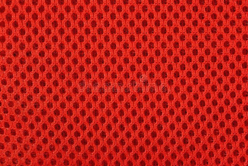 Textura no tejida anaranjada del fondo de la tela fotografía de archivo libre de regalías