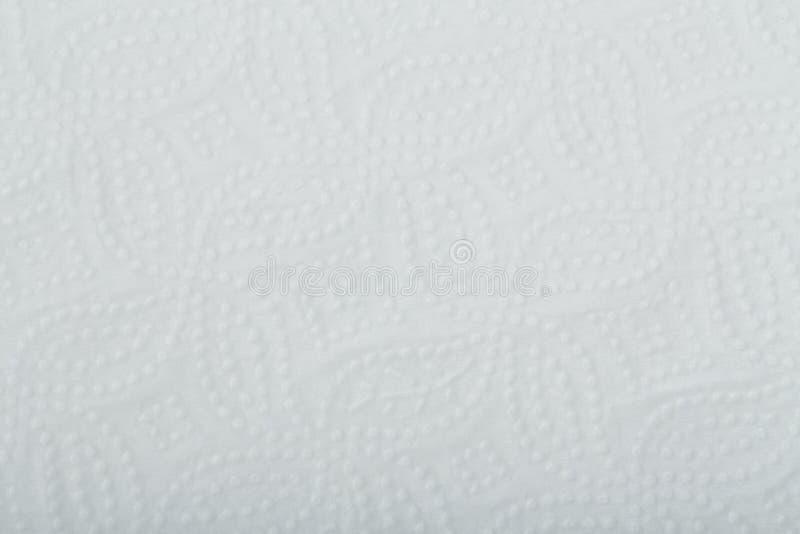 Textura o fondo de papel perforada blanca foto de archivo