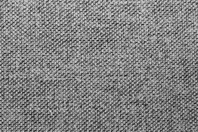 Textura o fondo mezclada gris y negra de la tela fotografía de archivo