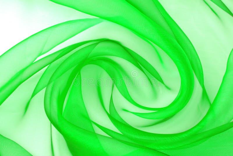 Textura ondulada de la tela verde de la organza imagenes de archivo