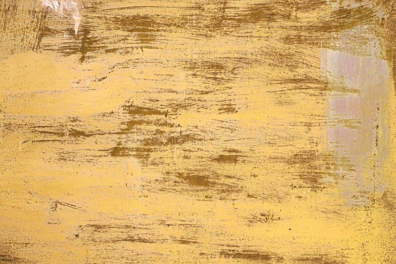Textura oxidada Fondo amarillo rasguñado pintado metálico foto de archivo libre de regalías