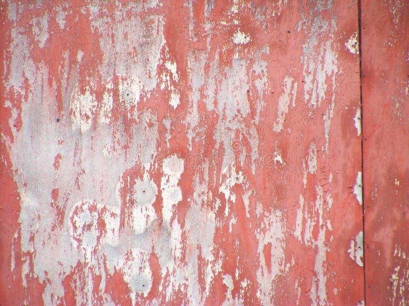 Textura oxidada velha do metal Superfície pintada casca do vermelho Fundo do Grunge com pintura danificada imagens de stock