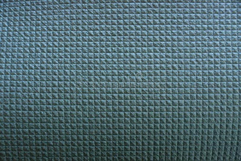 Textura plástica verde de um teste padrão quadrado imagem de stock royalty free