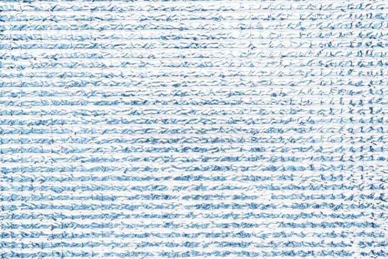 Textura prateada do polietileno Fundo brilhante cinzento Fim acima fotos de stock