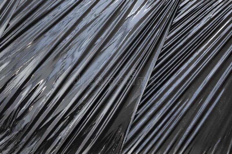 Textura preta do fundo do filme da embalagem do polietileno imagem de stock royalty free