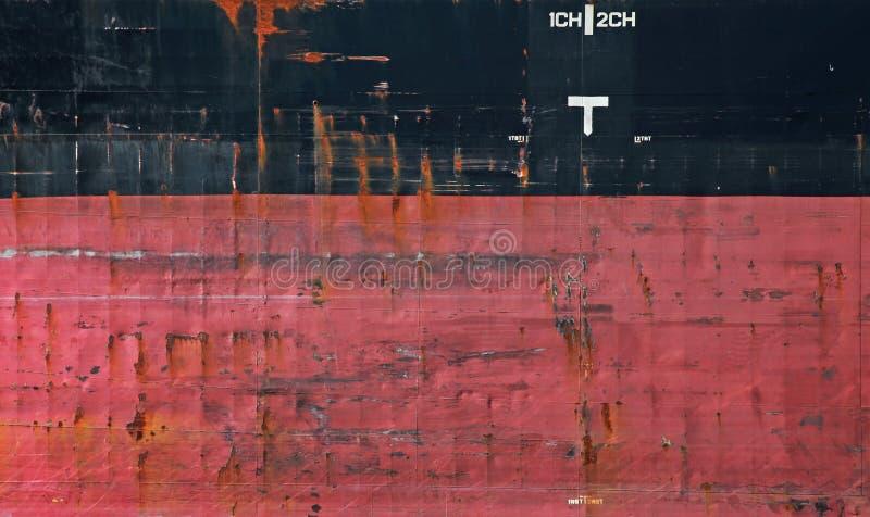Textura preta e vermelha da casca do navio de carga fotos de stock