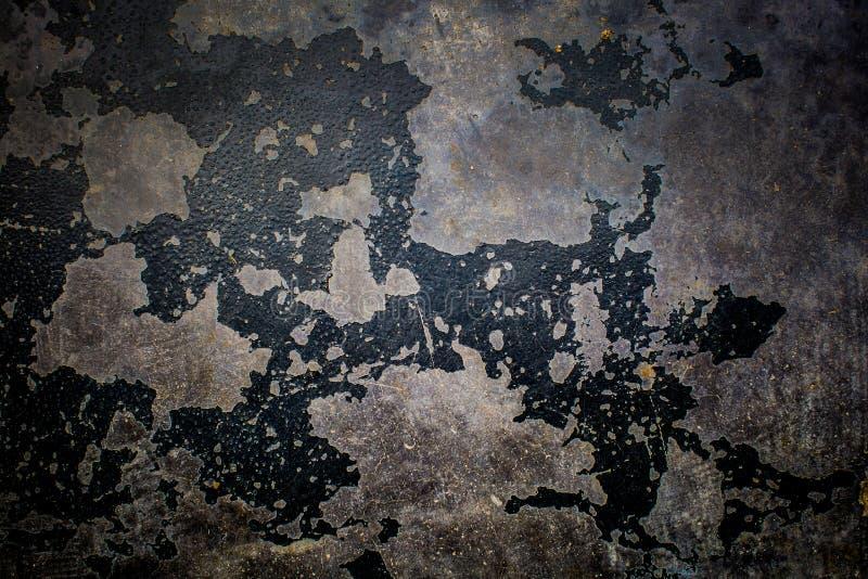 Textura preta velha da pintura que descasca fora o fundo do muro de cimento fotografia de stock