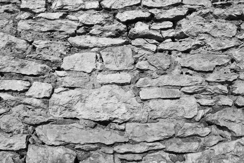 Textura preto e branco da parede de pedra fotografia de stock